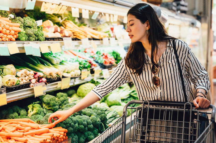 woman in supermarket shopping for healthy food
